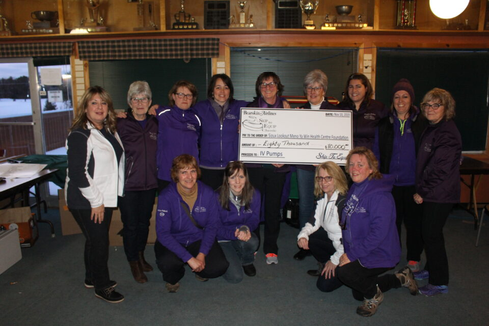 Group shot of the cheque donation during Bearskin Airlines Skip to Equip Classic.