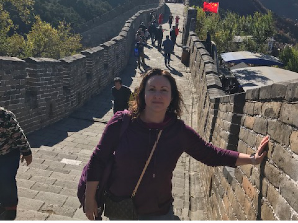 Brenda Voth standing on the Great Wall of China.